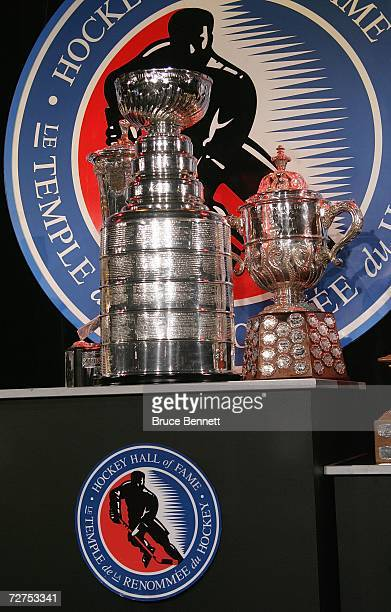 A view of the Stanley Cup and the Clarence S Campbell Bowl during a photo opportunity prior to the Hockey Hall of Fame Induction Ceremonies on...