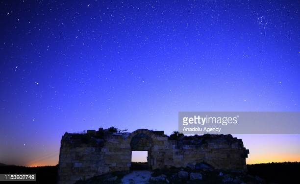 View of the starry night sky over the ruins at Blaundus ancient city at night in Ulubey district of Turkey`s Usak on July 03, 2019. Astronomy...