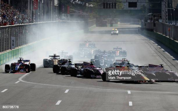 A view of the start showing Max Verstappen of the Netherlands driving the Red Bull Racing Red BullTAG Heuer RB13 TAG Heuer Sergio Perez of Mexico...