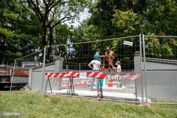 A view of the statue of Indro Montanelli during the cleaning after it was vandalised with red paint in the park dedicated to him on June 14 2020 in...