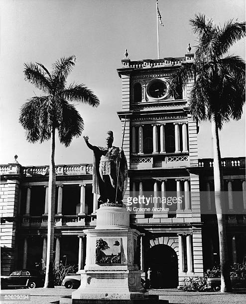 View of the statue of King Kamehameha I and the Ali'iolani Hale in downtown Honolulu, Hawaii, early 1940s. Originally intended to be a royal...