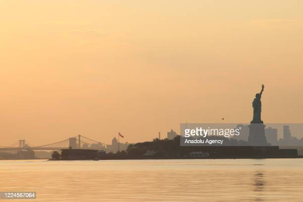 View of the Statue of Liberty at sunrise in New York City, United States on July 03, 2020.