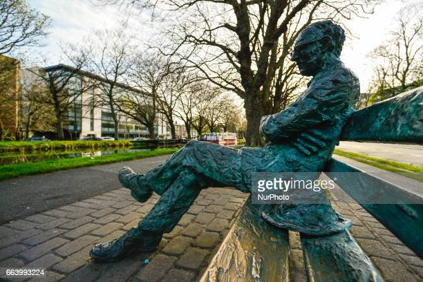 A view of the statue of Patrick Kavanagh on the banks of the canal as spring finally arrives in Dublin On Sunday April 2 in Dublin Ireland