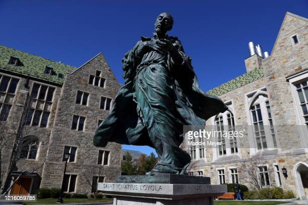 A view of the statue of Saint Ignatius Loyola at the campus of Boston College on March 31 2020 in Chestnut Hill Massachusetts Students at...