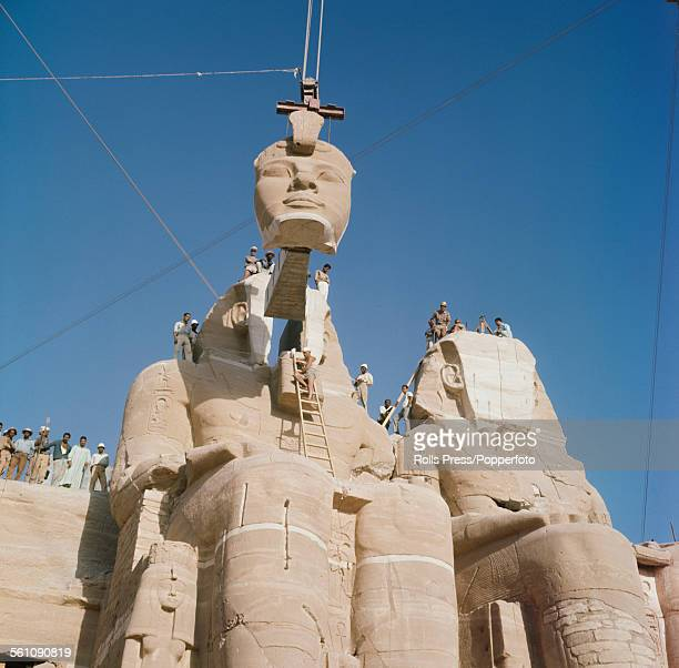 View of the statues of Pharoah Ramesses II at the Great Temple of Abu Simbel being reassembled after being moved to a new higher location to avoid...