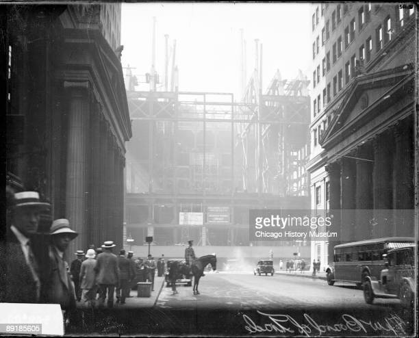 View of the steel frame of the new Board of Trade building during construction looking south on LaSalle Street located at the head of LaSalle Street...