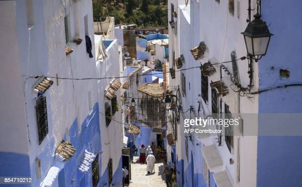 A view of the steps in the Medina of the northwestern Moroccan city of Chefchouen in the northern Rif region on September 19 2017 Huddling against a...