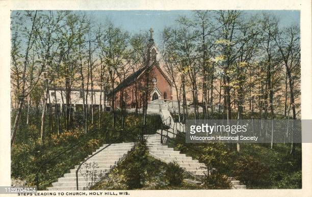 View of the steps leading up to the Carmelite Church of Our Lady, Help of Christians, Hartford, Wisconsin, 1910.