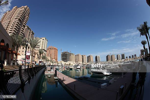 View of the still under construction manmade peninsula project called The Pearl with its highrise office buildings hotels shops and a yacht habour is...
