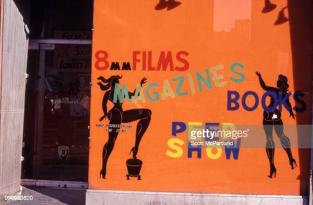 View of the store window and entrance of an unspecified sex shop on 42nd street in Manhattan's Times Square New York New York March 1 1970 The sign...
