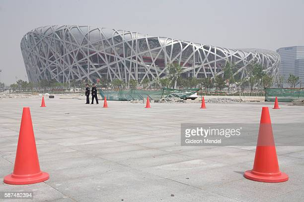 A view of the striking Beijing National Stadium The orange cones mark the route of a marathon fun run which was held as part of celebrations to mark...