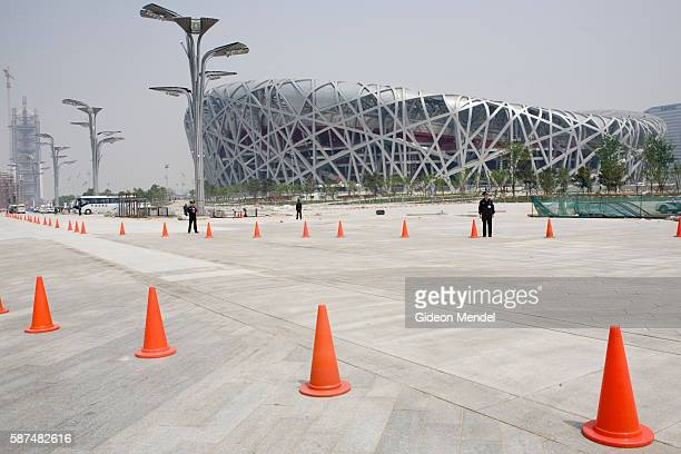 View of the striking Beijing National Stadium . The orange cones mark the route of a marathon fun run which was held as part of celebrations to mark...
