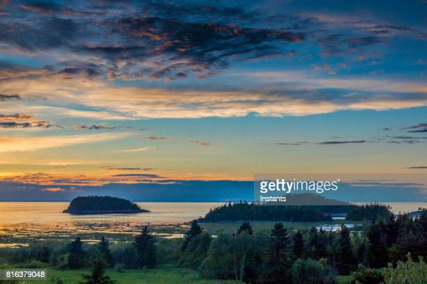 a view of the sun setting on le bic and its national park, in bas saint-laurent (lower saint lawrence) region, québec. - river st lawrence stock pictures, royalty-free photos & images