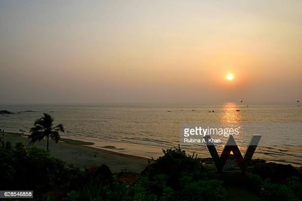 A view of the sun setting on the Arabian Sea and Vagator Beach from Rock Pool at W Goa on December 8 2016 in Goa India