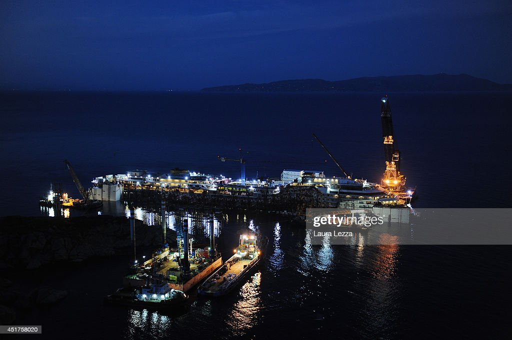 A view of the sunken ship Costa Concordia is seen the night before the last sponson is installed on the port side of the wrecked ship Costa Concordia on July 2, 2014 in Isola del Giglio, Italy. A total of 30 sponsons have been attached to the Costa Concordia to re-floate the ship wreck around July 10th. The wreckage will be removed by the end of July 2014 and will be toed to the port of Genoa for dismantling.