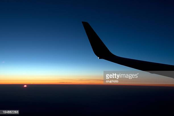 View of the sunrise out an airplane window