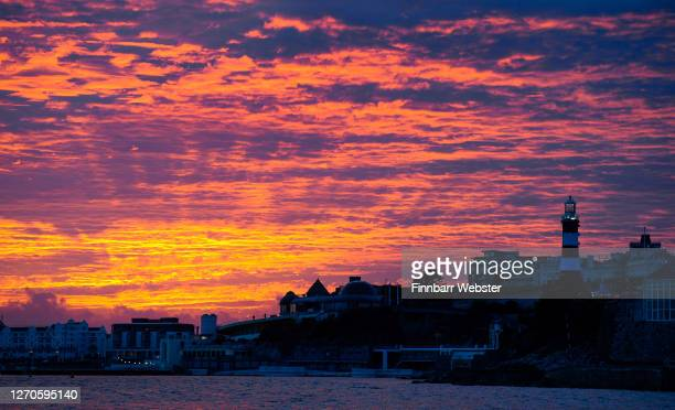 View of the sunset behind Plymouth Hoe at the harbour on September 03, 2020 in Plymouth, United Kingdom. Speedwell uses illuminated signage to ask...