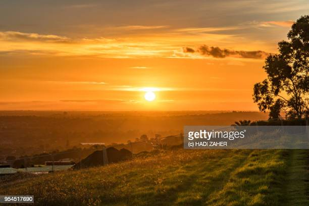 A view of the sunset over a grassy area in suburban Melbourne | Australia