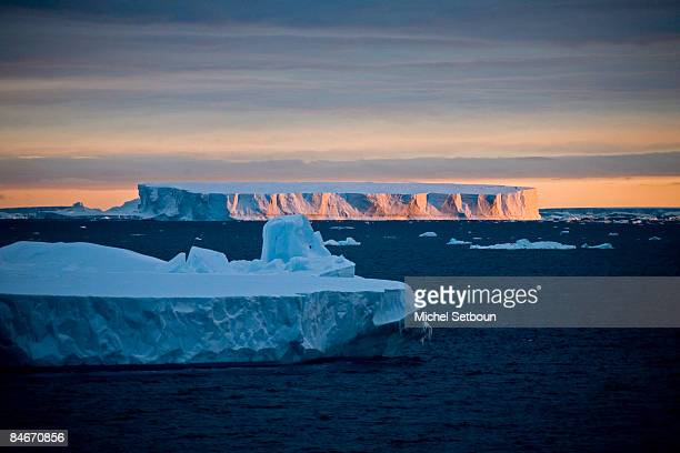 A view of the sunset over a tabular iceberg in the Weddell Sea during a voyage to Antarctica on a ship called Le Diamant during February 2006