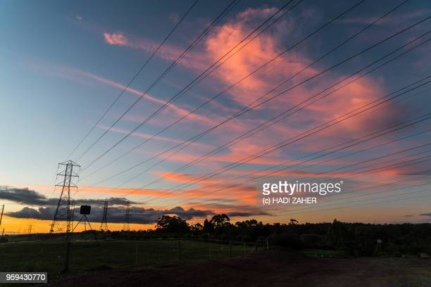 a view of the sunset over suburban melbourne | australia - power line stock pictures, royalty-free photos & images