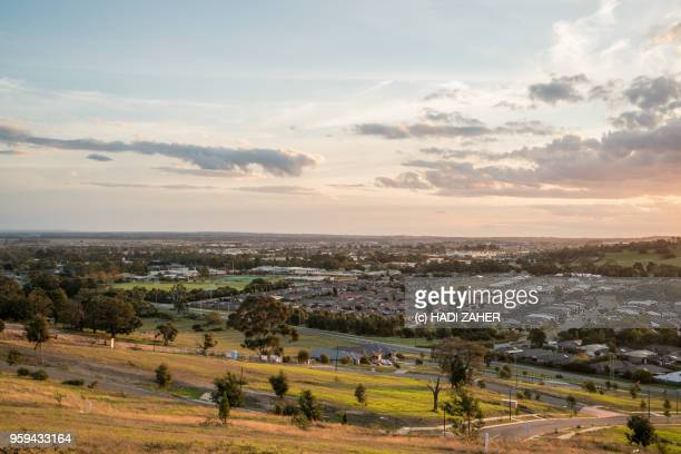 a view of the sunset over suburban melbourne | australia - urban sprawl stock pictures, royalty-free photos & images