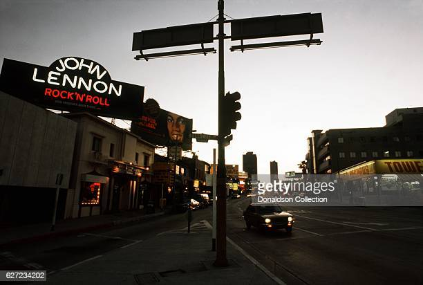View of the Sunset Strip looking west with billboards for John Lennon 'Rock 'N' Roll', Michael Jackson 'Forever, Michael', Mac Davis 'Burnin' Thing',...
