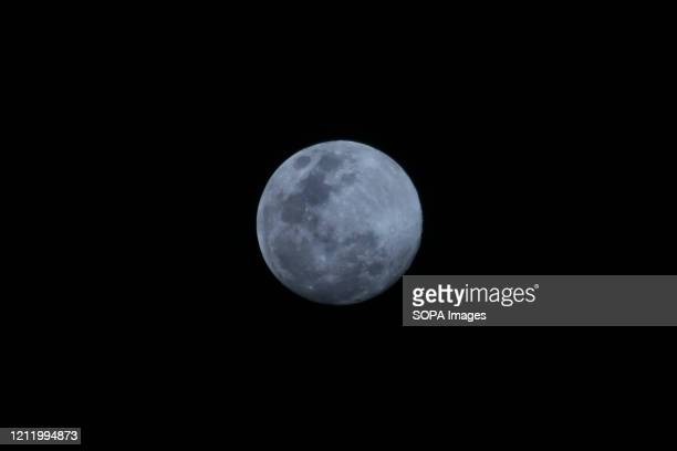 """View of the super moon also called the """"Flower moon"""". Super moon is a phenomenon when the moon is at the closest distance to the earth, so it looks..."""