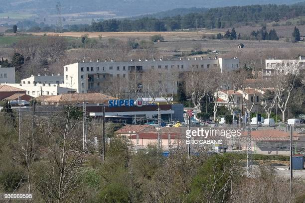 TOPSHOT A view of the Super U supermarket in the town of Trebes southern France where a man took hostages on March 23 2018 At least three people were...