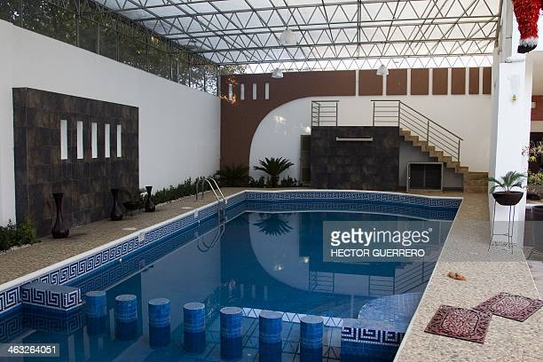 View of the swimming pool at the house of drug trafficker Enrique Plancarte aka 'Quique Plancarte' in Nueva Italia state of Michoacan Mexico on...