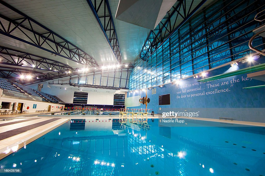 View of the swimming pool at the indoor hall is taken at the ASPIRE Academy for Sports Excellence on January 6, 2013 in Doha, Qatar. ASPIRE Zone, also knowmn as Doha Sports City which is an huge area of 250 hectar including 10 football trainings grounds, big indoor arena for football, track and field, basketball and so on, as well as a big swimming pool with olympic measure and two hotels called The Torch and The Grand Heritage. The two German Bundesliga clubs FC Bayern Muenchen and Schalke 04 place their winter training camp there every January. The Khalifa International football stadium is also placed at Aspire Zone. The FIFA World Cup 2022 will take place in Qatar.