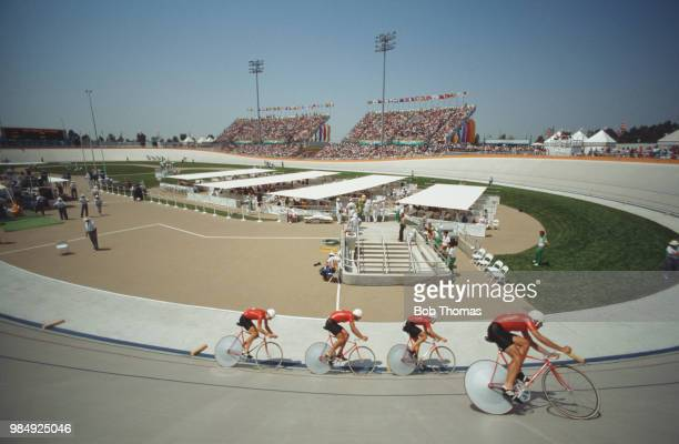 View of the Switzerland cycling team of Daniel Huwyler, Hans Ledermann, Hansrudi Marki and Jorg Muller competing in qualification during the Men's...