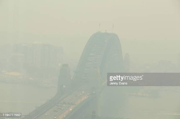 A view of the Sydney Harbour Bridge shrouded in smoke on December 19 2019 in Sydney Australia NSW Premier Gladys Berejiklian has declared a state of...
