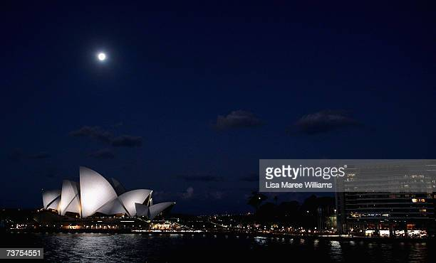 View of the Sydney Opera House prior to turning it's main lights off during Earth Hour March on 31, in Sydney, Australia. The entire city of Sydney,...