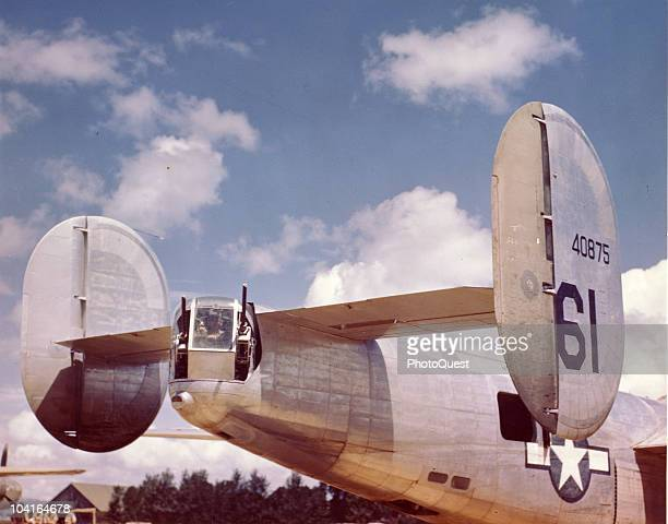 View of the tail turret of a Consolidated B24 Liberator heavy bomber at a base in England 1940s