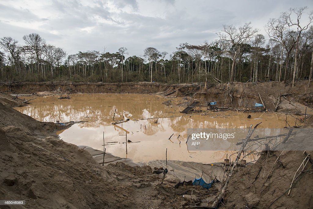 View of the tailings produced by illegal gold mining in Mega 13, Madre de Dios region, Peru, on January 25, 2014, during a police operation. AFP PHOTO / Sebastian Castañeda