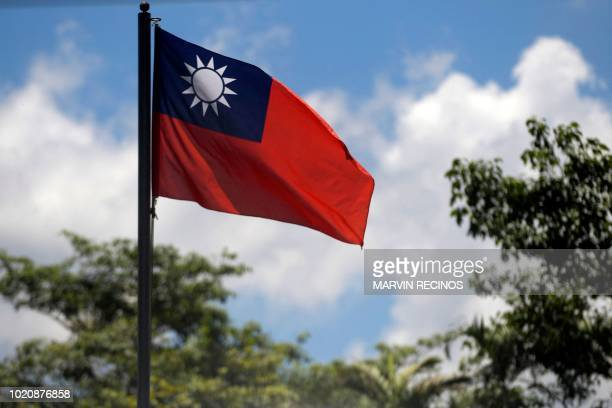 View of the Taiwan flag at the Embassy of Taiwan in San Salvador on August 21, 2018. - China and El Salvador established diplomatic relations Tuesday...