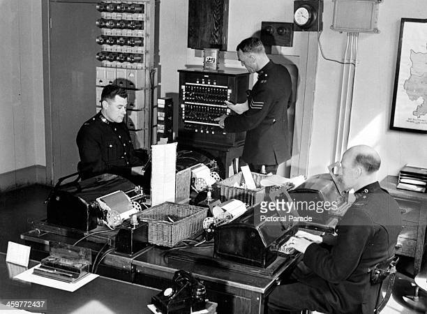 View of the Teleprinter room at Scotland Yard, connected with 23 London police divisions in London, England. Circa 1950.