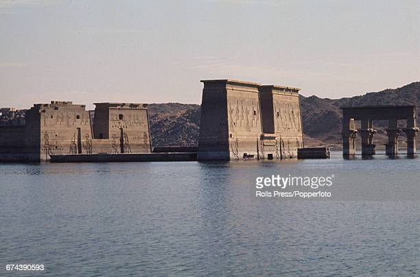1971 view of the temple complex of Philae located on the island of Philae in the River Nile in Egypt and flooded by construction of the Aswan Low Dam...