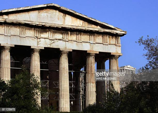 A view of the Temple of Hephaistos inside the ancient Agora at the foot of Athens' Acropolis hill as the Temple of Parthenon is seen in the...