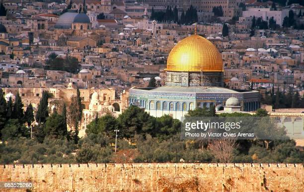 View of the Temple of the Mount, the Dome of the Rock, the old town and its surrounding walls from the Mount of Olives or Mount Olivet in Jerusalem, Israel