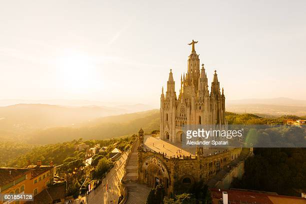 view of the temple of the sacred heart of jesus at tibidabo mountain, barcelona, catalonia, spain - barcelona spain stock photos and pictures