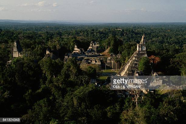 View of the Temples from the archaeological site of Tikal rising up out of the forest Tikal National Park El Peten Guatemala Mayan civilisation...