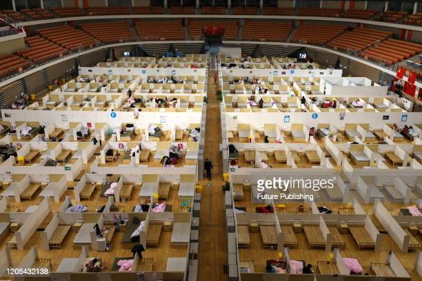 View of the temporary hospital for the COVID-19 patients set up in a gymnasium in Wuhan in central China's Hubei province Thursday, March 05, 2020....