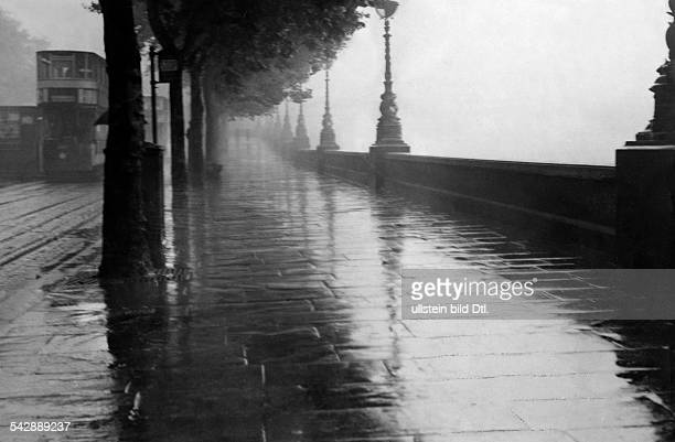 View of the Thames Embankment London on a rainy and foggy day