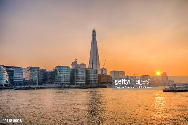 a view of the thames river and the shard building at sunset in london, england - 2019 stock pictures, royalty-free photos & images