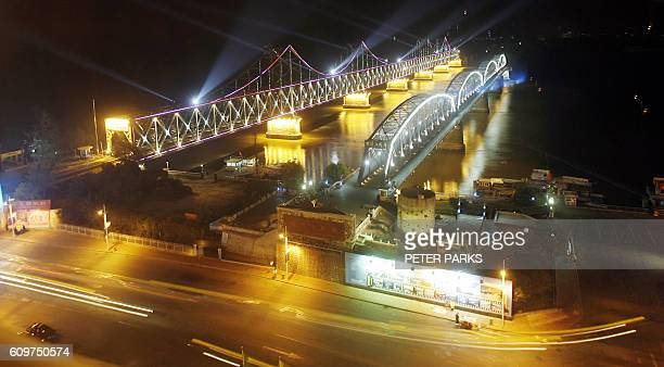 """View of the the Friendship Bridge and the """"Broken Bridge"""" which was bombed by the US during the Korean war over the Yalu River which borders North..."""