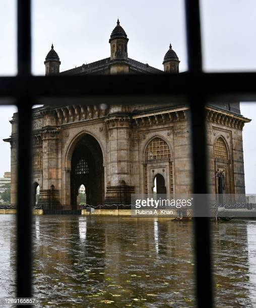 View of the the Gateway of India through the iron barricades on August 21, 2020 in Mumbai, India.