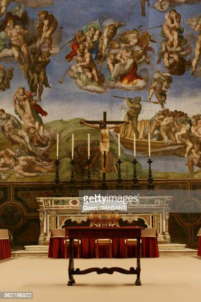 View of the 'The Last Judgment' by the Italian Renaissance painter Michelangelo covering the whole altar wall of the Sistine Chapel in Vatican City...