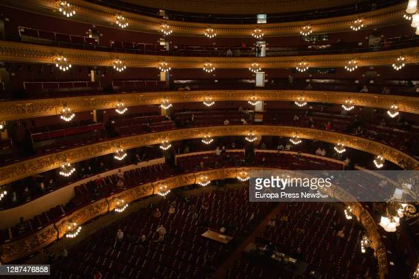 A view of the theatre boxes and the seating area during the rehearsal of a scene from 'La Traviata' with piano soloists and chorus in the Liceu on...