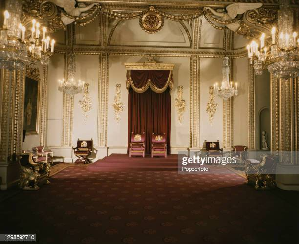 View of the Throne Room, containing the two throne Chairs of Estate, at Buckingham Palace, London residence of King George VI, August 1947.